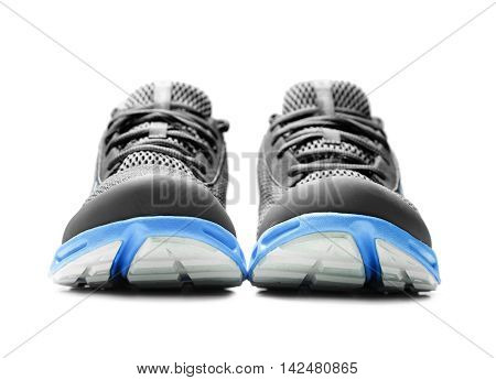Unbranded sneakers isolated on a white background.