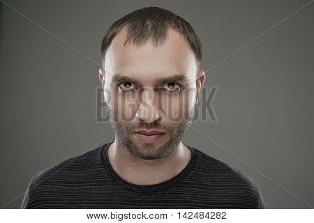 Portrait of hostile unshaven serious caucasian man