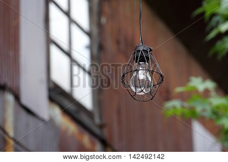 Dirty old light bulb in abandoned barn