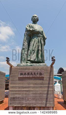 KOCHI JAPAN - JULY 19 2016: Statue of Sakamoto Ryoma in front of Kochi railway station Japan. Sakamoto Ryoma (1836-1867) was a leader of anti-shogun movement during Bakumatsu period