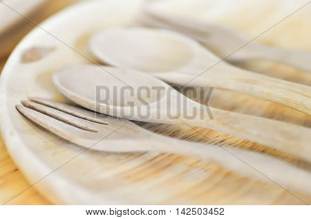 wooden spoon wooden fork and wooden dish on the table
