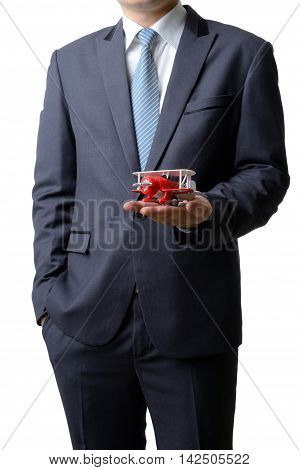 Businessman gives the model airplane to the customer isolated on white background airline business concept