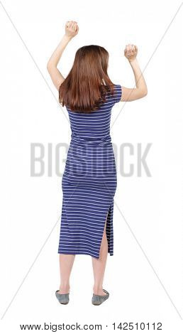 Back view of  woman.  Raised his fist up in victory sign.    Raised his fist up in victory sign.  Rear view people collection.  backside view of person.  Isolated over white background. The brunette