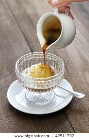 affogato, pouring espresso coffee to ice cream, italian simple dessert