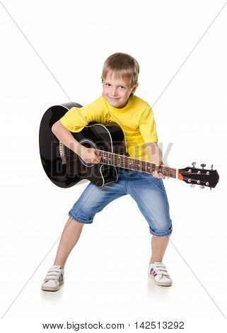 boy stands and plays on guitar isolated on white background
