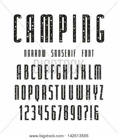Narrow sanserif font with speckled texture. Bold face. Black print on white background