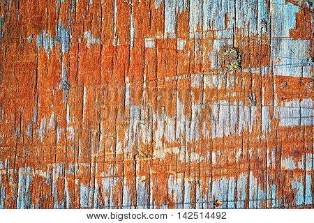 Old Wooden Flaky Orange Painted Board With Lots Of Notchings, Background