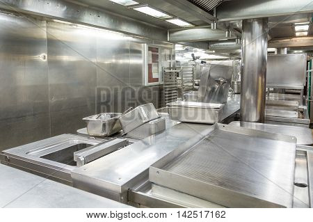 Stainless Steel Grill and Trays in Commercial Kitchen