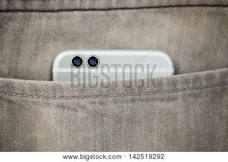 Modern Dual Camera Smart Phone In Jeans Pocket