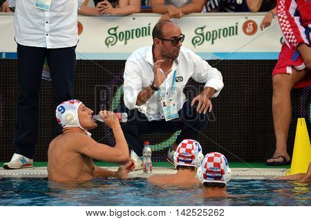 Budapest Hungary - Jul 15 2014. Ivica Tucak (head coach) talking to the croatian team. The Waterpolo European Championship was held in Alfred Hajos Swimming Centre in 2014.