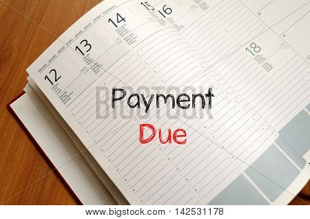 Payment due text concept write on notebook