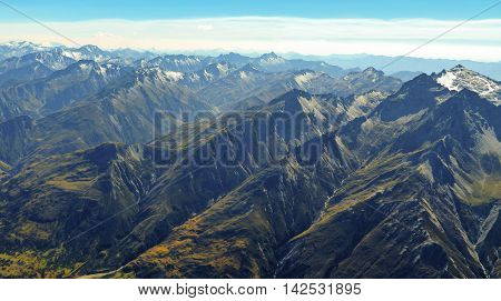 Mountain range with snow capped peaks and valleys