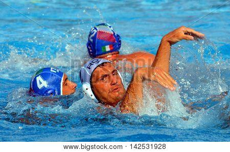 Budapest Hungary - Jul 15 2014. Waterpolo ballet a' la Pietro FIGLIOLI (ITA 4) and .Cosmin RADU (ROM 2). The Waterpolo European Championship was held in Alfred Hajos Swimming Centre in 2014.
