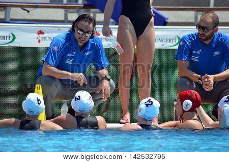 Budapest Hungary - Jul 16 2014. VAMVAKARIS Konstantinos head coach talking to the greek team. The Waterpolo European Championship was held in Alfred Hajos Swimming Centre in 2014.