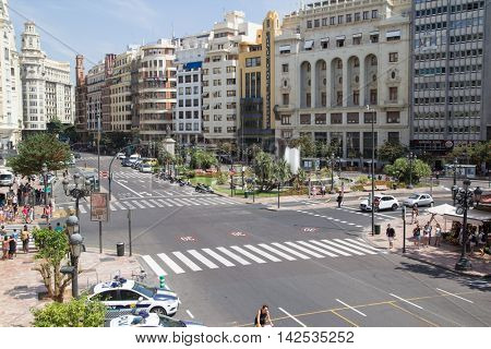 VALENCIA, SPAIN - AUGUST 11, 2016: The Ayuntamiento Plaza from above with unidentified people below in downtown Valencia. This plaza is the central plaza in the old town of Valencia, Spain.
