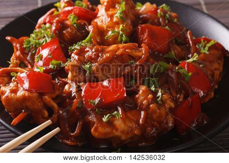 Pork In Sweet And Sour Sauce With Peppers, Carrots And Onions Macro. Horizontal