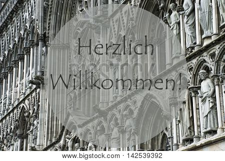 Church Of Trondheim In Norway. Macro Or Close Up Of Sculptures Or Statue. Religious Greeting Card. German Text Herzlich Willkommen Means Welcome
