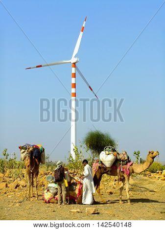 Jaisalmer, India-february 20: Unidentified People Stand Near Wind Turbine During Safari On February