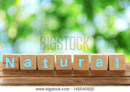Word naturel on wooden blocks. Ecological concept.ogical concept.