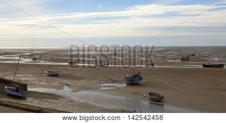 MORETON, ENGLAND, JULY 3. The Wirral Coast on July 3, 2016, north of Moreton, England. A fleet of boats is left aground at low tide on the northern coast of the Wirral Peninsula near Moreton England.