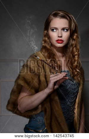 portrait of 1940s woman with cigarette with dark background