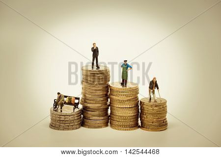 People of various social groups on pile of coins. Financial concept.