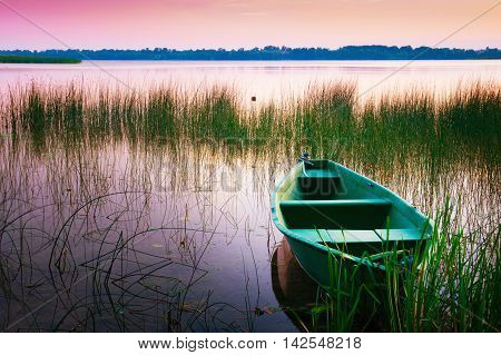 Rowing boat floating over the Lake Lasmiady waters. Masuria Poland.