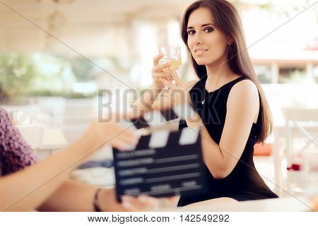 Happy Actress Holding a Glass in Movie Scene