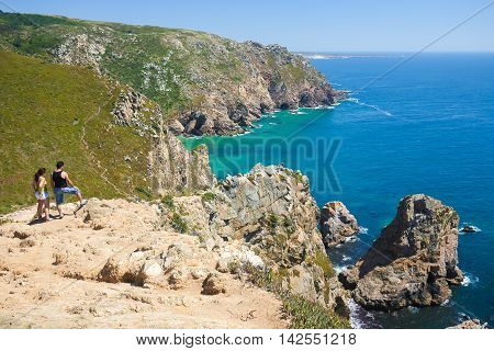 SINTRA PORTUGAL - JULY 15 2016: Cabo da Roca is a cape located close to Lisbon which forms the westernmost extent of mainland Portugal and continental Europe.