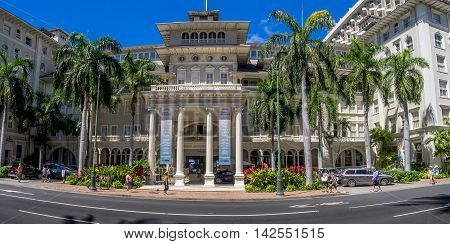 HONOLULU, HI - AUG 2: Front exterior panorama of the Moana Surfrider on August 2, 2016 in Honolulu. Known as the First Lady of Waikiki, is a famous historic hotel on the island of Oahu built in 1901.