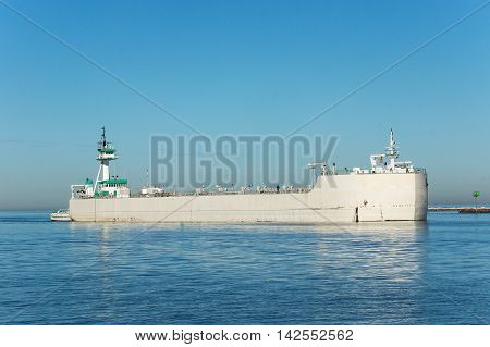 An articulated tugboat and barge enter the Port of Cleveland, Ohio on Lake Erie