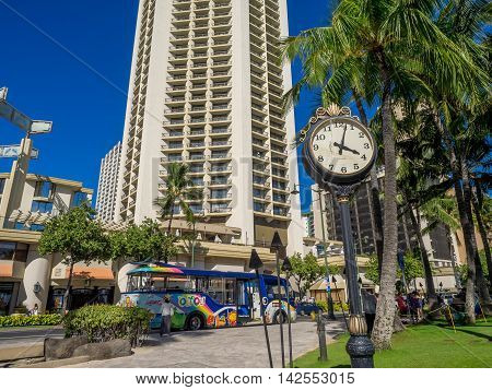 HONOLULU, HI - AUG 4: An old victorian era clock at Waikiki Beach on August 4, 2016 in Honolulu, Hawaii. Waikiki Beach is a popular destination for sun loving tourists.