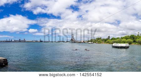 OAHU, HI - AUG 5, 2016: The USS Arizona Memorial and USS Missouri on August 5, 2016 in Pearl Harbor, USA. Memorial marks resting place of sailors and Marines who died when the USS Arizona was sunk by Japan.
