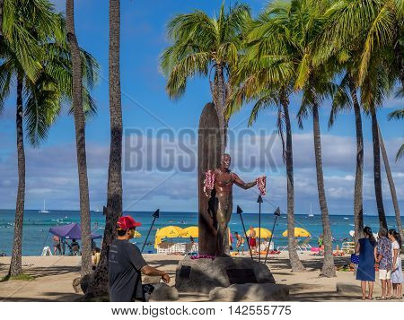 WAIKIKI, HI - AUG 6: Duke Kahanamoku Statue on Waikiki Beach on August 6, 2016 in Honolulu. Duke famously popularized surfing and won gold medals for the USA in swimming.