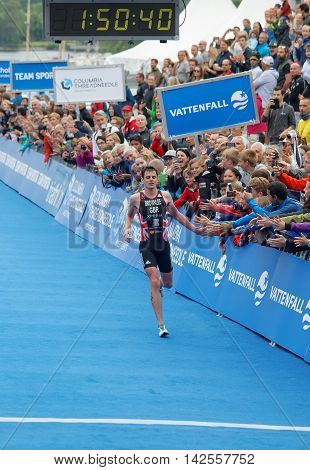 STOCKHOLM - JUL 02 2016: Running triathlete Jonathan Brownlee (GBR) on the second place at the finish in the Men's ITU World Triathlon series event July 02 2016 in Stockholm Sweden