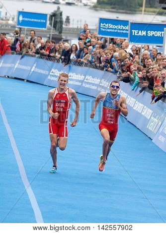 STOCKHOLM - JUL 02 2016: Tough fight between running triathletes Schilling and Alarza at the finish in the Men's ITU World Triathlon series event July 02 2016 in Stockholm Sweden