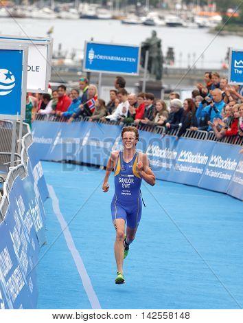 STOCKHOLM - JUL 02 2016: Swedish triathlete Gabriel Sandor fighting on the finish in the Men's ITU World Triathlon series event July 02 2016 in Stockholm Sweden