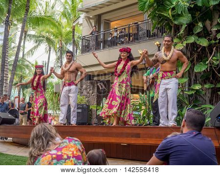 HONOLULU, HI - AUG 6: Entertainment in the Garden courtyard of the Royal Hawaiian Shopping Centre on August 6, 2016 in Honolulu. Waikiki tourists enjoy the many stores and restaurants.
