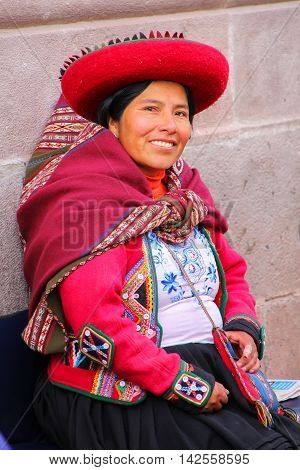 Cusco, Peru - January 20: Unidentified Woman In Traditional Dress Sits In The Street On January 20,