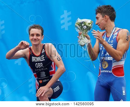 STOCKHOLM - JUL 02 2016: The smiling triathlete medalist Alistair and Pierre Le Corre on the podium in the Men's ITU World Triathlon series event July 02 2016 in Stockholm Sweden