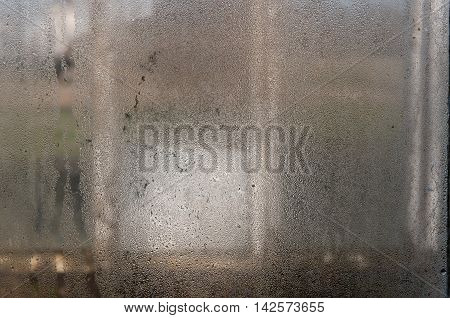 Fogged glass. Wet window. Abstract background. Water on window.