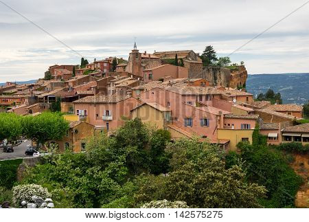 View on the beautiful medieval village of Roussillon. It ochre village is included in list of