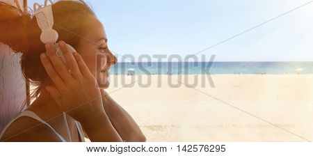 Portrait Handsome Young Woman Listening Music Player Headphones Sea Beach Background.Pretty Girl Enjoy Audio Smiling Closed Eyes.Beauty Lifestyle Fashion Hipster People Summer Concept.Space.Sunlight