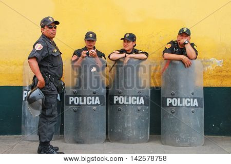 Lima, Peru-january 31: Unidentified Policemen Standwith Riot Shields  On January 31,2015 In Lima, Pe