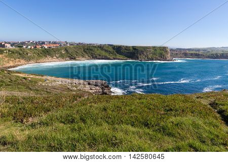View of the town on the high coast ocean. Spain suburb of Suances summer day in the Province of Cantabria it is photographed from Playa de Los Locos.