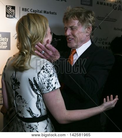 NEW YORK-APR 27: Honoree Robert Redford (R) hugs actress Elizabeth Moss at the 42nd Chaplin Award Gala at Alice Tully Hall, Lincoln Center on April 27, 2015 in New York City.