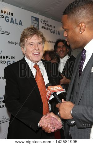 NEW YORK-APR 27: Honoree Robert Redford (L) speaks to TV personality A. J. Calloway at the 42nd Chaplin Award Gala at Alice Tully Hall, Lincoln Center on April 27, 2015 in New York City.