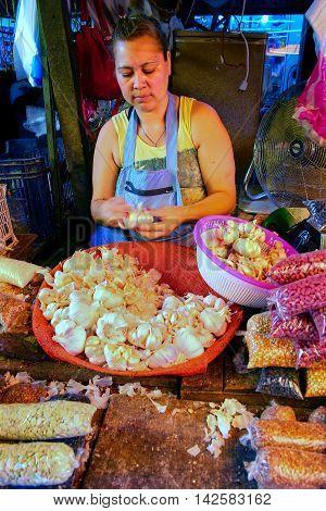 Asuncion, Paraguay - December 26: Unidintified Woman Peels Garlic At Mercado Cuatro On December 26,