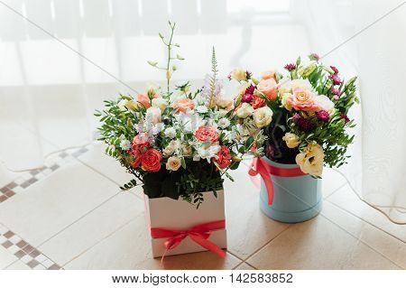Two Beautiful bouquet of bright flowers in basket for wedding ceremony