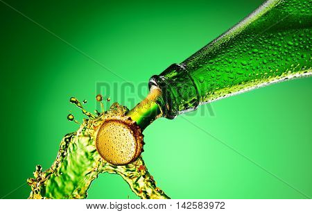 Beer green bottle neck and cap macro shot. Bottle opening with exploding and splashing